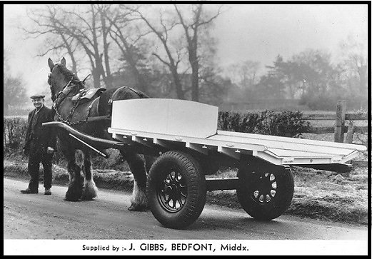 A flat cart built by Gibbs.  The floor sloped inwards to keep produce boxes secure.