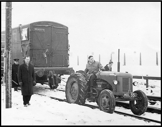 Gordon Dennett, manager of the Bracknell branch, pulling a railway truck at Bracknell Station during severe weather in 1963.